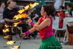 Carolyn Mabry holding fire fans