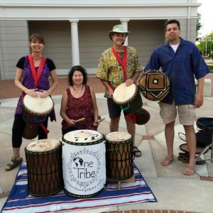 One Tribe band members with drums
