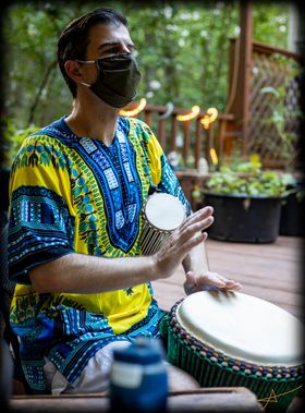 drummer brian playing djembe and talking drum